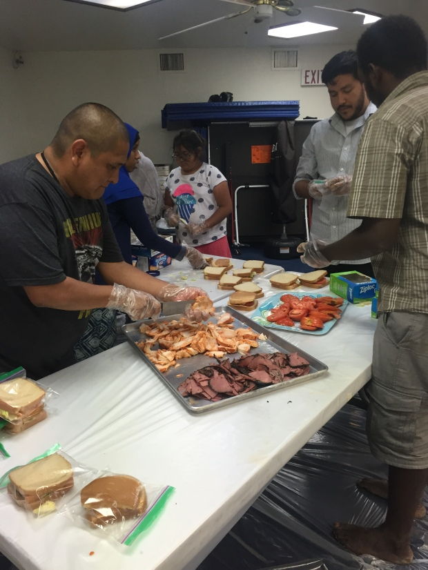 Volunteers at ICC make sandwiches for homeless (Maham Haq)